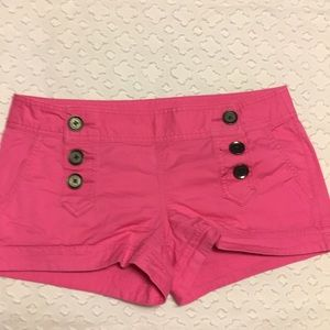 Express hot pink ultra low cut shorts with buttons